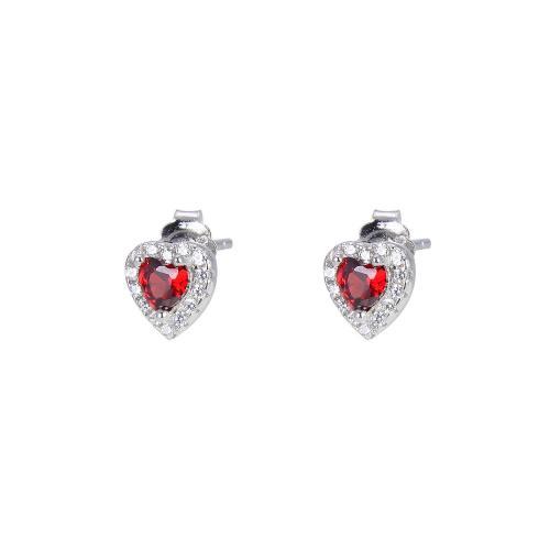 Sorea sydänkorvakorut punaisella kivellä